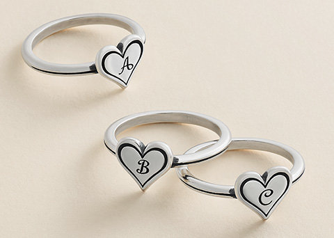 Image features three new Delicate Heart Initial Rings in sterling silver, letters A-C shown.