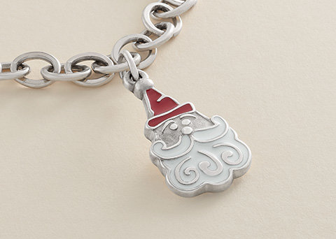 Image features the new Enamel Sweet Santa Charm in sterling silver featuring a red-enameled hat and a white-enameled beard.