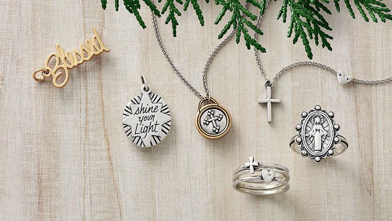 Two charms featuring messages of faith, two faith necklaces featuring crosses and two faith-inspired rings.