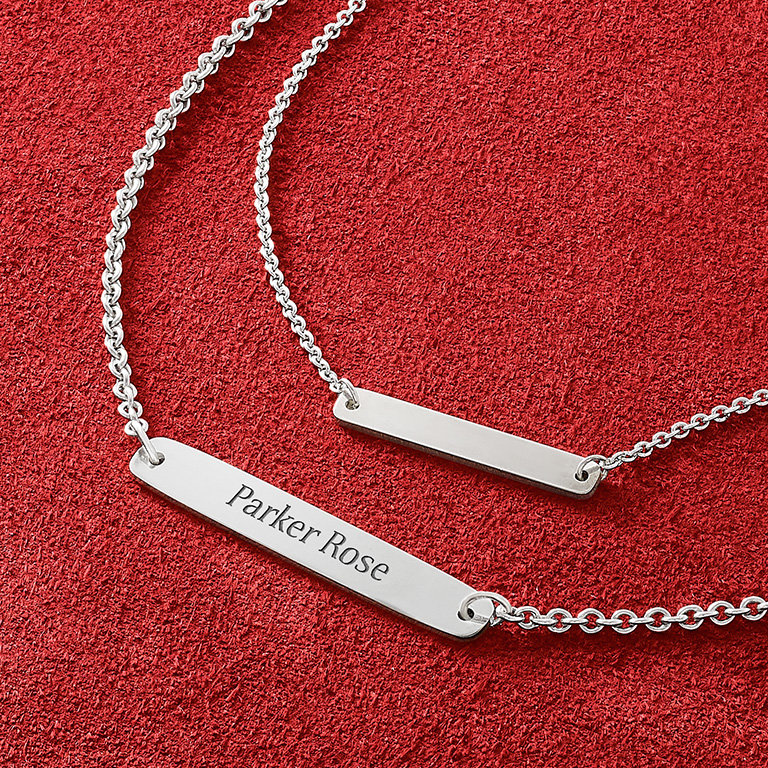 "The new Engravable Horizon Necklace engraved with the customized name ""Parker Rose"" and the Petite Engravable Horizon Necklace shown without engraving."