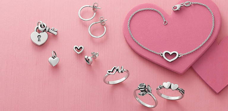 An assortment of charms, earrings, rings and a bracelet for Valentine's Day.