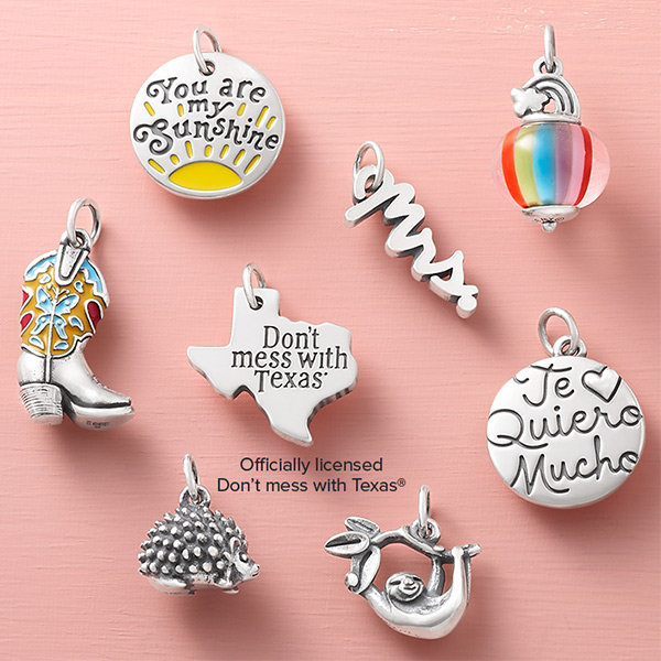 Two new charms featuring messages of faith in sterling silver.