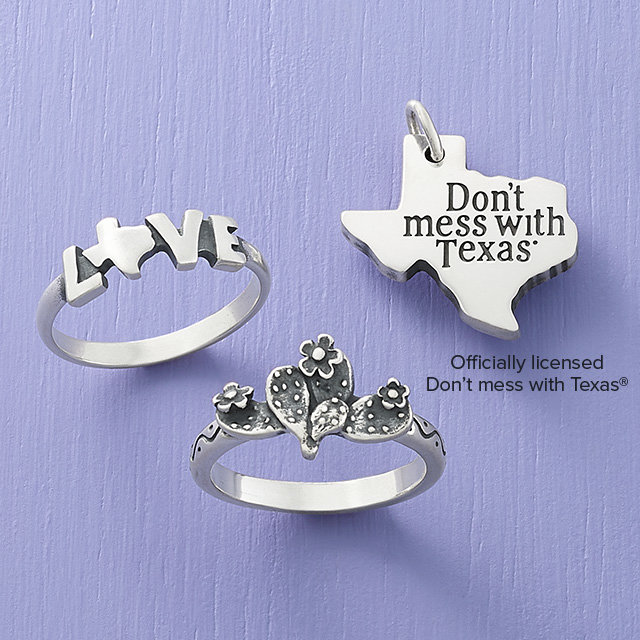 An assortment of sterling silver Texas-themed jewelry.