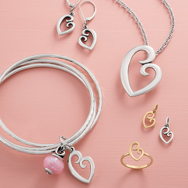 An assortment of our Mother's Love Collection in sterling silver and 14K gold.