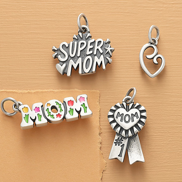 An assortment of sterling silver mom-themed charms.