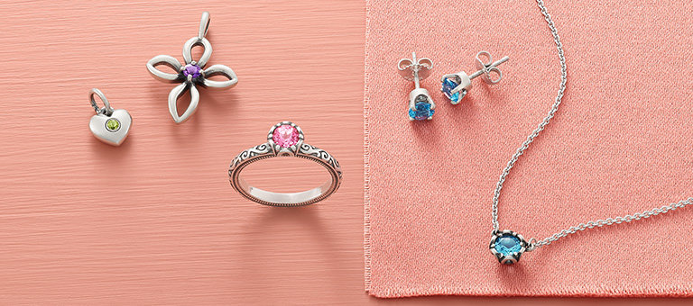 An assortment of gemstone jewelry in a variety of colors.