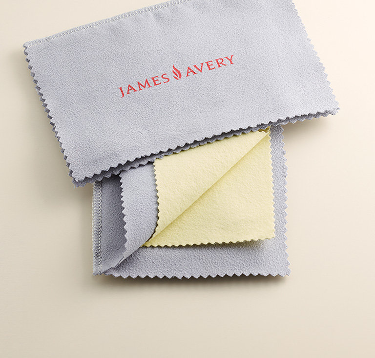 The Bronze and Silver Polishing Cloth with the James Avery logo.