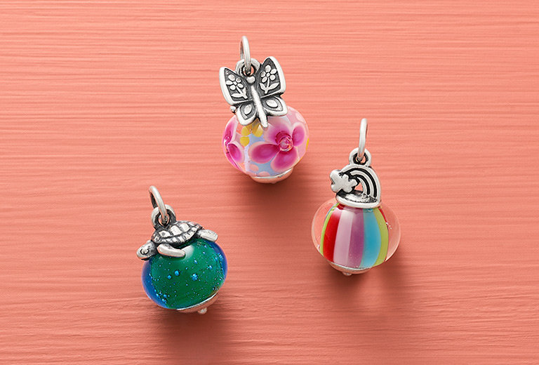 An assortment of colorful Avery Art Glass Charms.