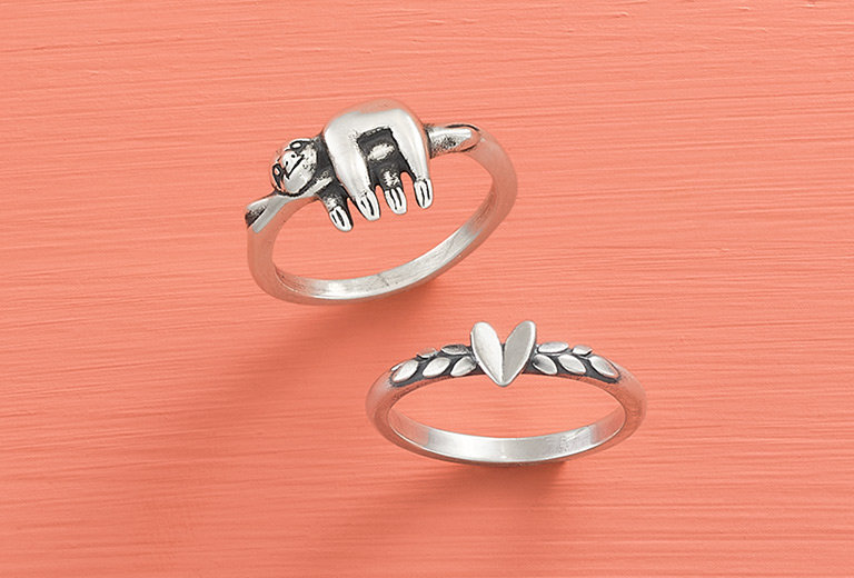 The Happy Sloth Ring and Heart and Vine Ring in sterling silver.