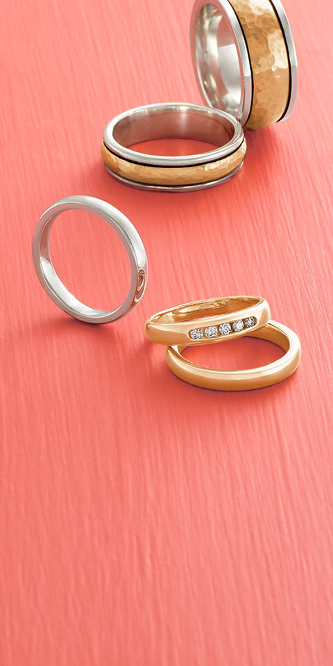 An assortment of wedding rings and wedding bands in sterling silver and gold.