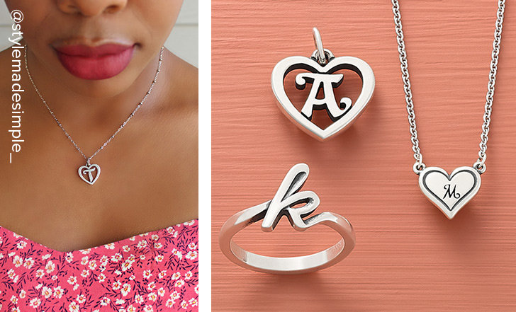 Woman wearing the sterling silver Heart Script Initial Charm on a Forged Beaded Chain. An assortment of letter designs in a variety of styles including charms, rings and necklaces.