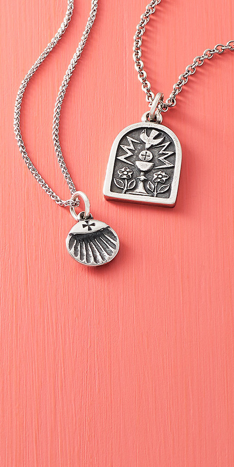 The Baptismal Shell Charm and the Confirmation Charm on necklace chains.