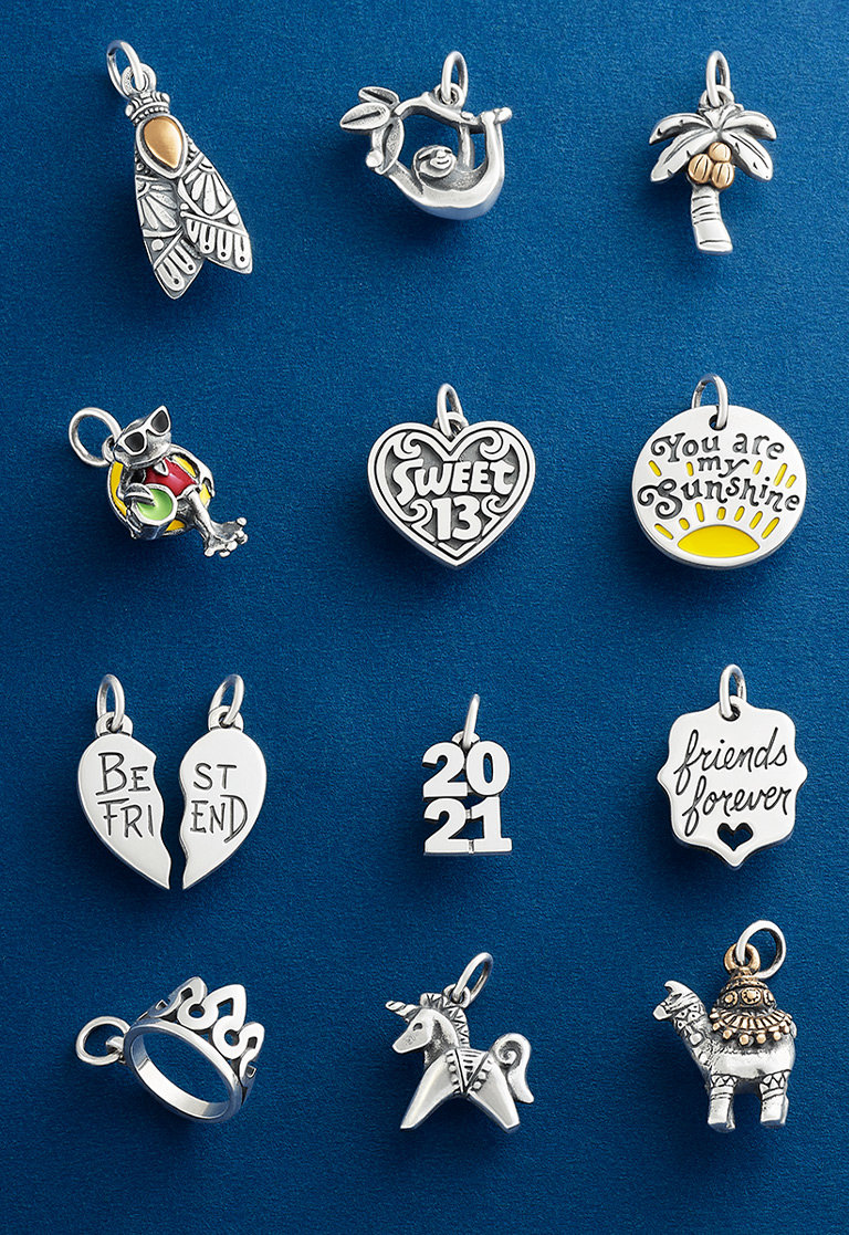 An assortment of charms crafted in sterling silver with bronze and enamel accents.