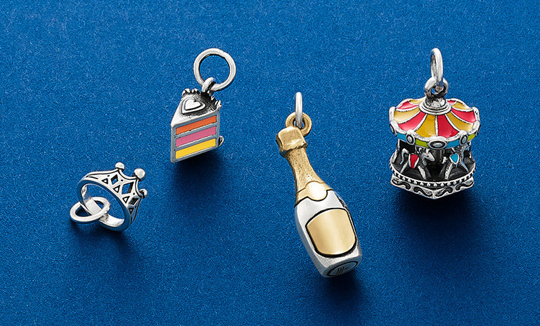 An assortment of new charms in sterling silver and 14K gold and pops of colorful enamel.